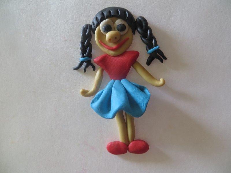 Поделки из пластилина: девочка с косичками
